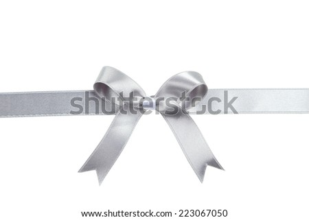 Silver ribbon with bow on white background - stock photo