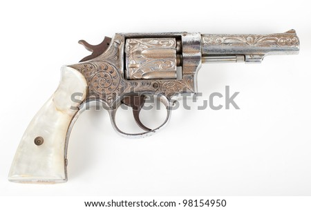 silver rusty old pistol isolated on white background - stock photo