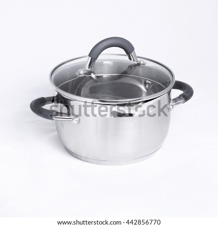 Silver saucepan on a gray background