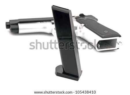 Silver Semi Auto handgun with loader on white. - stock photo