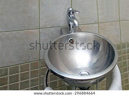 Silver Shiny Oval Sink in Modern Bathroom - stock photo