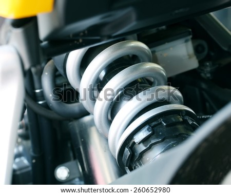 Silver shock Absorber's motorcycle . focus on suspension. - stock photo