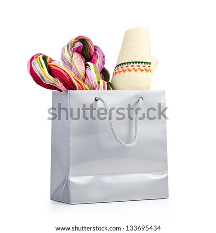 Silver shopping bag with gift on white background. - stock photo