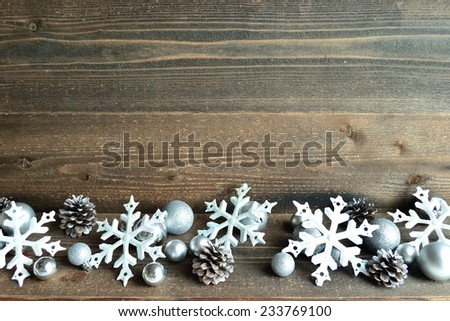 Silver snow flakes ornaments with pine cones.image of Christmas and winter season - stock photo