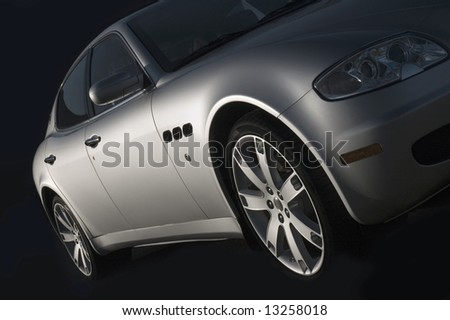 Silver sports car isolated on black. Soft side light. - stock photo