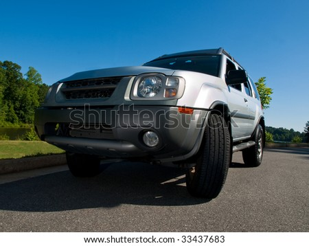 Silver Sports Utility Vehicle low angle view SUV - stock photo