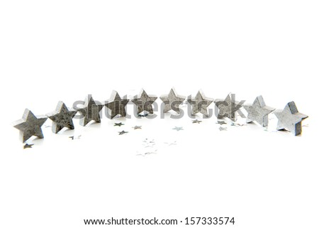 silver stars for christmas in a long row - stock photo