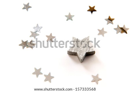 silver stars for christmas on a white background - stock photo
