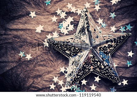 silver stars over old vintage paper - stock photo