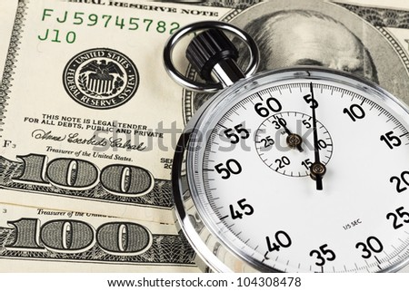 silver stopwatch closeup 5 sec on two hundred dollar bills - stock photo