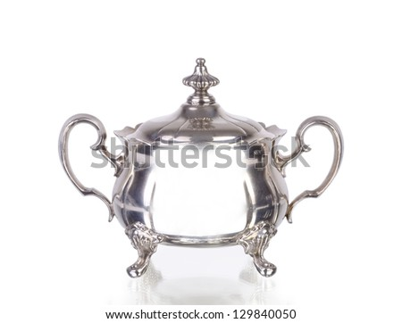silver sugar bowl on white background with reflection