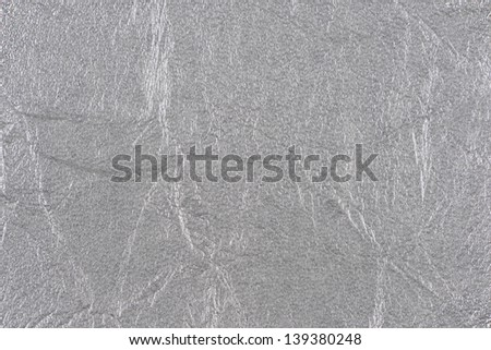 Silver synthetic leather with embossed texture background