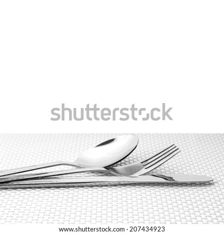 Silver tableware on white background with pattern