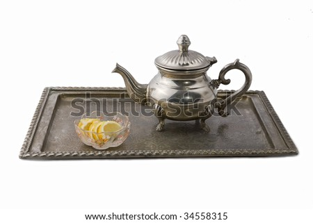 Silver tea pot on a tray - stock photo