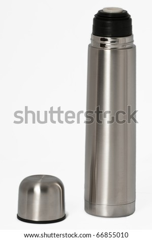 Silver thermos with it's cap un attached on a seamless white background - stock photo