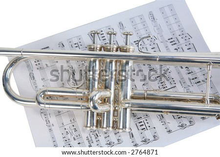 Silver trumpet over sheet music