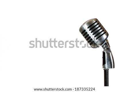 Silver vintage microphone in the studio on white background - stock photo