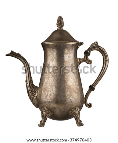 Silver vintage tea kettle with engravings isolated on white background