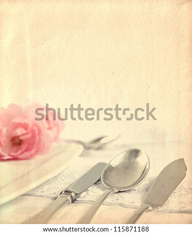 Silver wares and romantic decoration with roses,on a white table-cloth on old paper background,vintage style - stock photo