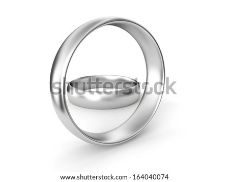 Silver wedding rings on white background - stock photo