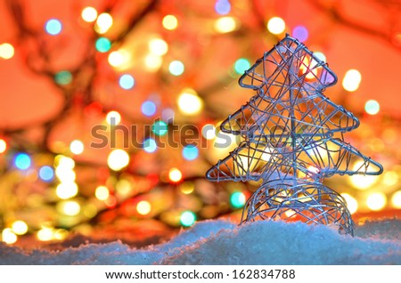 silver wired christmas tree on background with Christmas lights - stock photo
