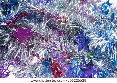 Silver with rainbow colors xmas and new year tinsel background - stock photo