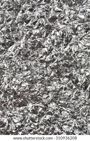 Silver wrinkled and shrunken foil surface, crinkly, crushed metallic background - stock photo