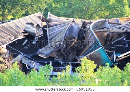 SILVERLAKE, KS - JULY 10: massive train derailment on the Soldier Creek bridge that happened around 6:00pm spilling thousands of tons of coal into the creek on July 10, 2010 in Silverlake, KS.