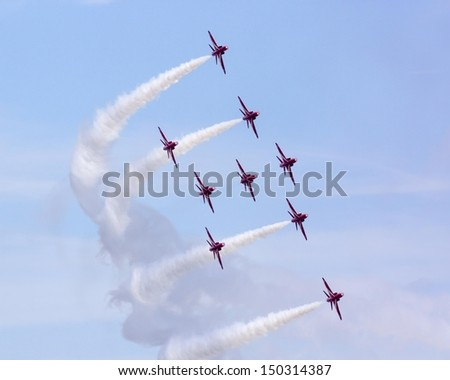 SILVERSTONE, ENGLAND - JUNE 30:  RAF aerobatics display team the Red Arrows give a display prior to the British Grand Prix on June 30, 2013.