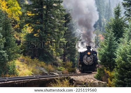 SILVERTON, COLORADO- SEPT 21: Restored steam train of Durango & Silverton RR runs as visitor attraction on Sept 21, 2014. - stock photo