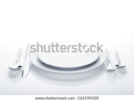 Silverware or flatware set and plates. Isolated on white background - stock photo