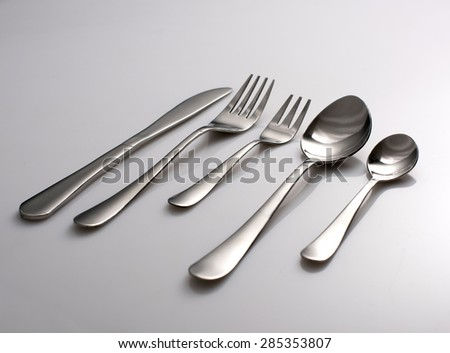 Silverware or flatware set of fork, spoons and knife