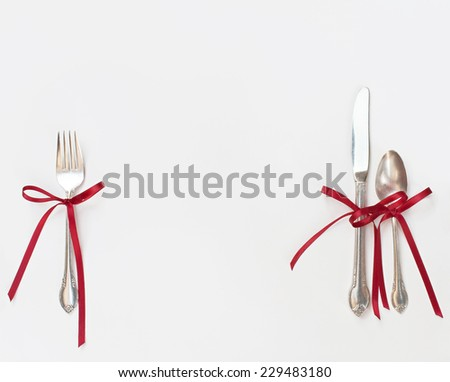 Silverware with Red Bows - stock photo