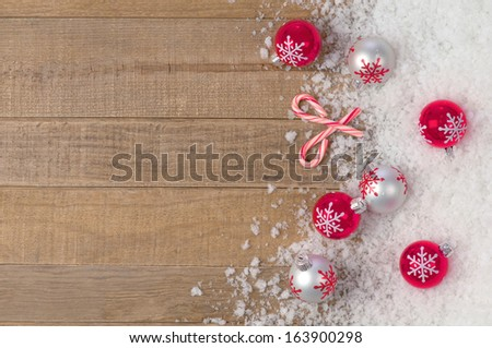 Silvery Christmas Snowflake Ornament in Snowbank on Rustic Wood background with Room or Space for Copy, Text, or your Words, Vertical - stock photo