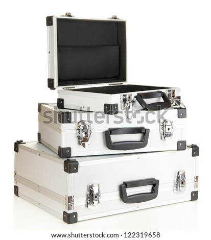 Silvery suitcases isolated on white