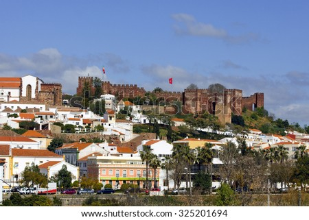 SILVES, PORTUGAL - MARCH 13: The Panorama features the skyline of the old part of Islamic fortress from the 8th century and it is in the list of national monuments of Silves,Portugal on March 13, 2015