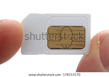 sim card in my fingers  - stock photo