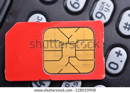 Sim card on cell phone close up - stock photo