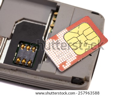 SIM card on smart phone isolated - stock photo