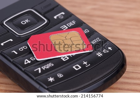 SIM Card over the Phone on the table - stock photo