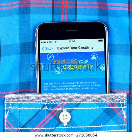 Simferopol, Russia - April 18, 2015: black Apple iPhone 6 in the pocket displaying explore your creativity inscription in the Apple store. - stock photo