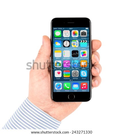 SIMFEROPOL, RUSSIA - JANUARY 10, 2015: Apple iPhone 6 displaying applications icons on the screen. The iPhone 6 and iPhone 6 Plus are smartphones running iOS developed by Apple Inc. - stock photo