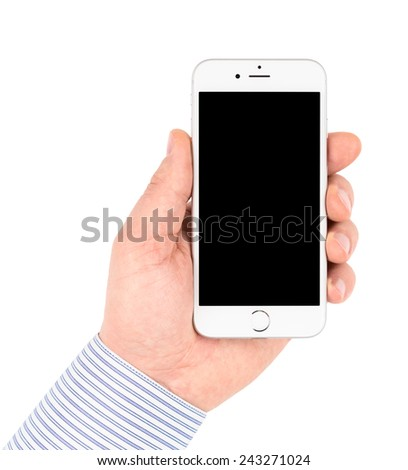 SIMFEROPOL, RUSSIA - JANUARY 10, 2015: Hand takes Apple iPhone 6 on white background turned off with black display. The iPhone 6 and iPhone 6 Plus are smartphones running iOS developed by Apple Inc. - stock photo