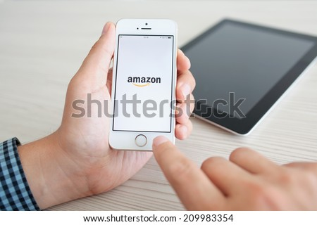 Simferopol, Russia - July 14, 2014: Amazon the American company selling goods and services on the Internet worldwide. - stock photo