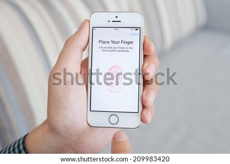 Simferopol, Russia - July 14, 2014: Touch ID the scanner of fingerprints developed by Apple corporation. Allows users to unblock the smartphone and to make purchases. - stock photo