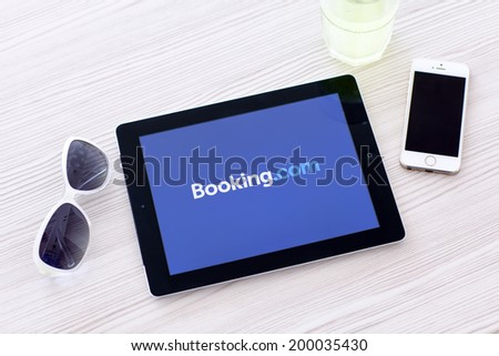 Simferopol, Russia - June 22, 2014: Booking.com the system online hotel reservations. Is founded in Amsterdam in 1996. - stock photo
