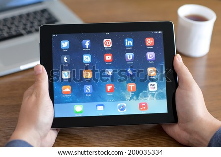 Simferopol, Russia - June 22, 2014: Displaying social media network program known brands on the screen iPad from Apple. - stock photo