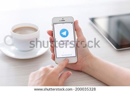 Simferopol, Russia - June 22, 2014: Telegram is free messenger from Pavel Durov for smartphones. Messenger allows you to exchange text messages and files. - stock photo