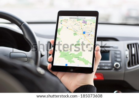 Simferopol, Russia - March 30, 2014: Apple Maps cartographical service from the Apple company for the iOS and MacOSX systems. It was created on September 19, 2012 together with the large iOS updating. - stock photo