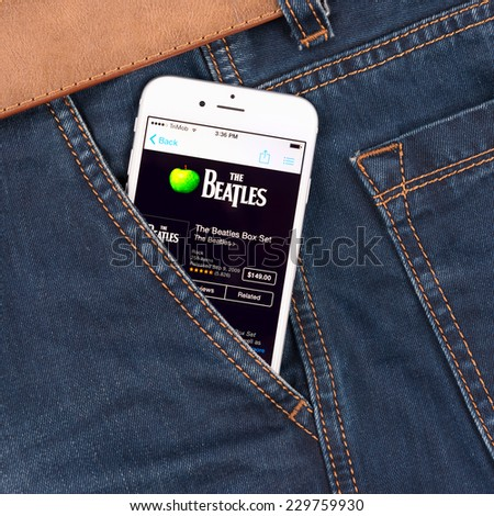 SIMFEROPOL, RUSSIA - NOVEMBER 11, 2014: Apple iPhone 6 in jeans pocket displaying Beatles band music in iTunes. The Beatles were an English rock band that formed in Liverpool, in 1960. - stock photo